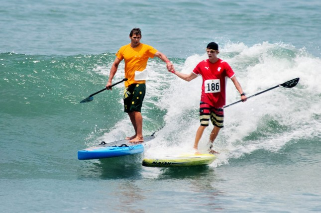 Jamie Mitchell Casper Steinfath high five ISA Stand Up Paddle World Championship Peru