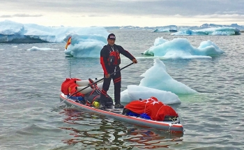 Antonio de la Rosa paddle boarding Greenland