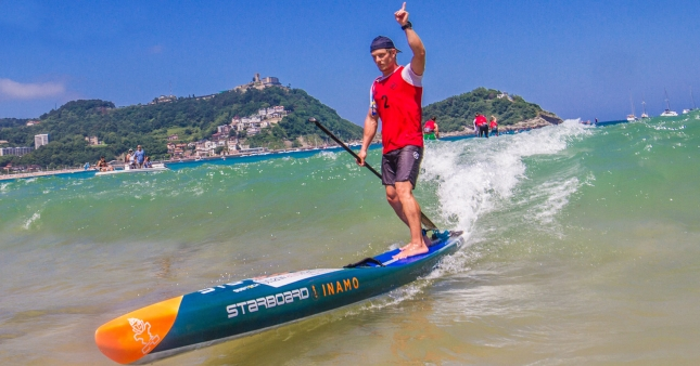 Michael Booth stand up paddling